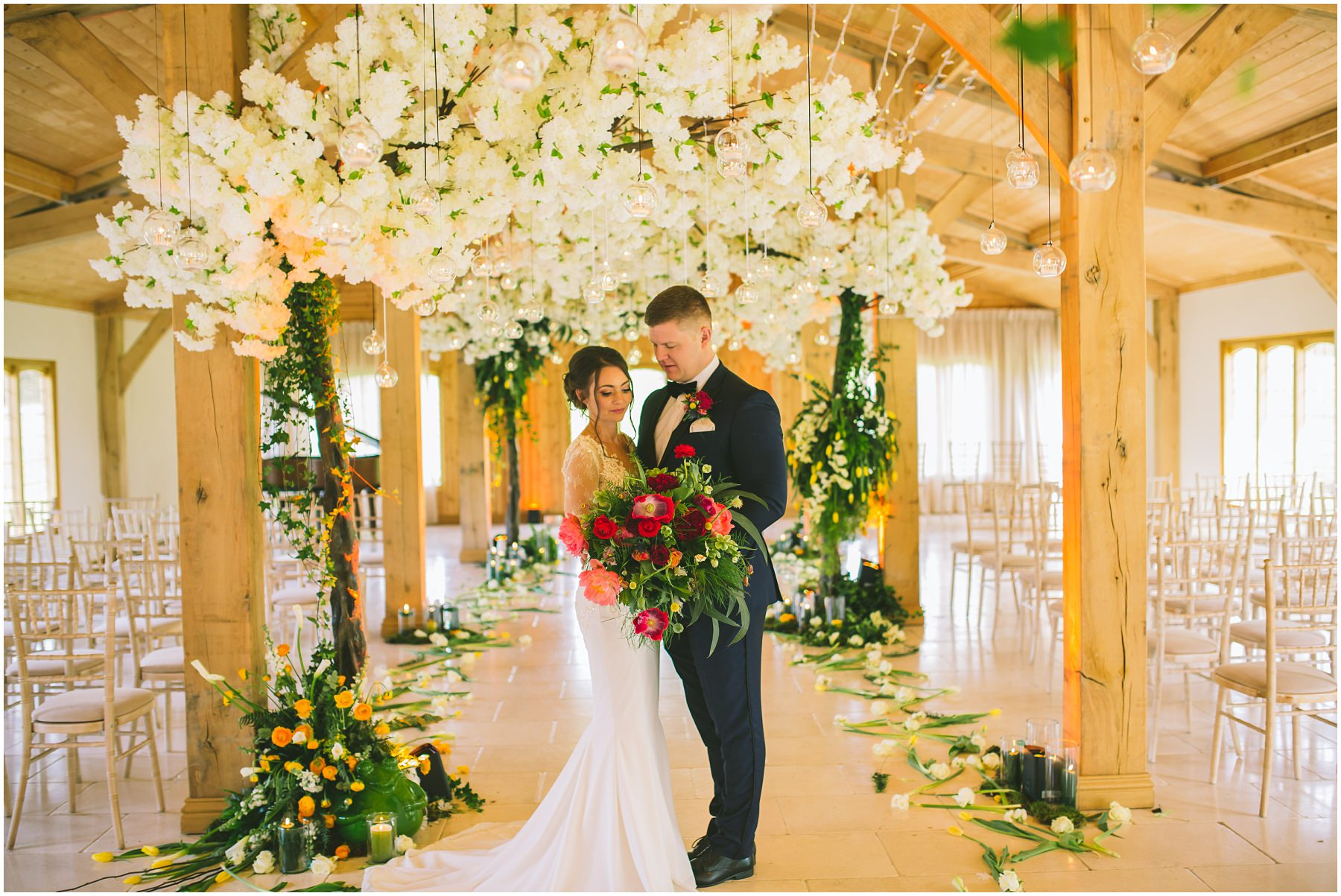 Inside the ceremony room at Colshaw Hall decorated by Red Floral Architecture