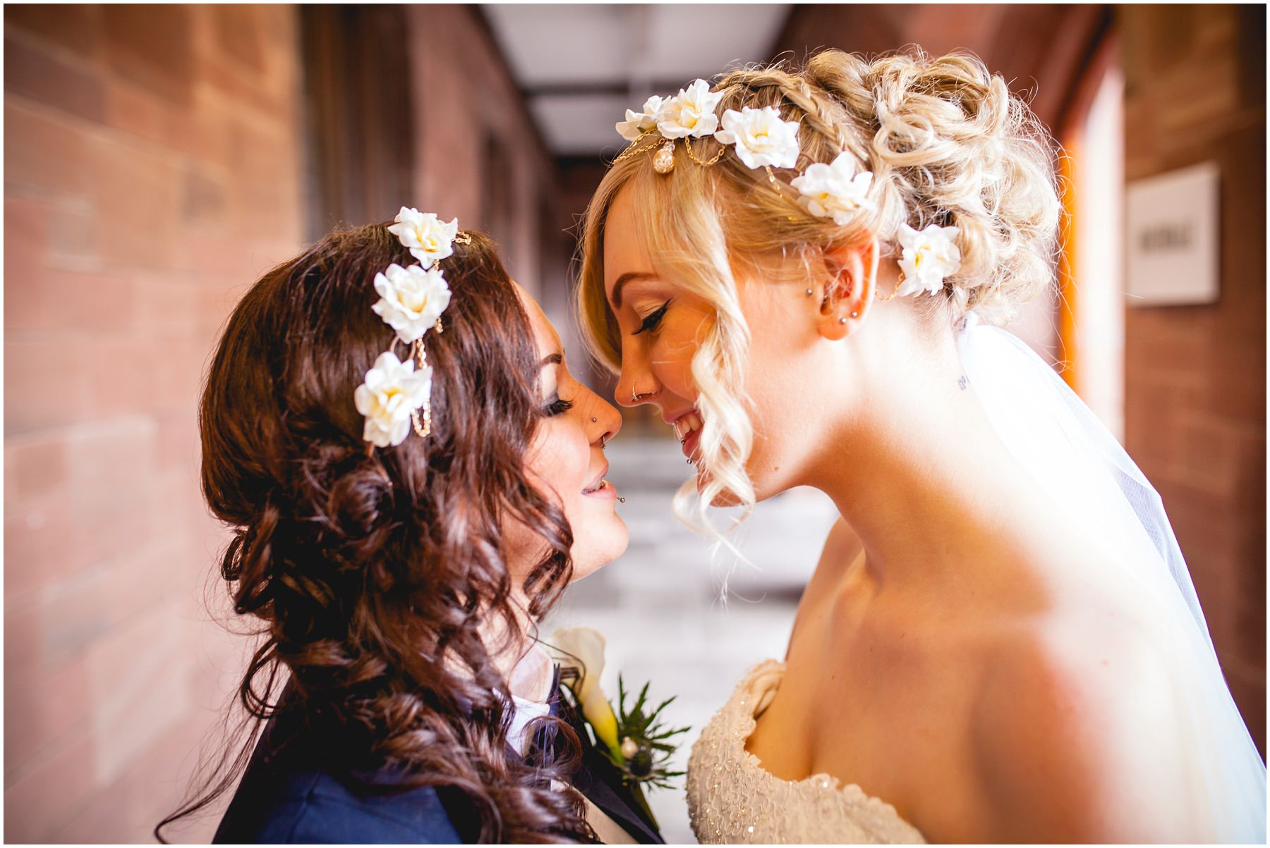 Two brides share a moment at Bolton School