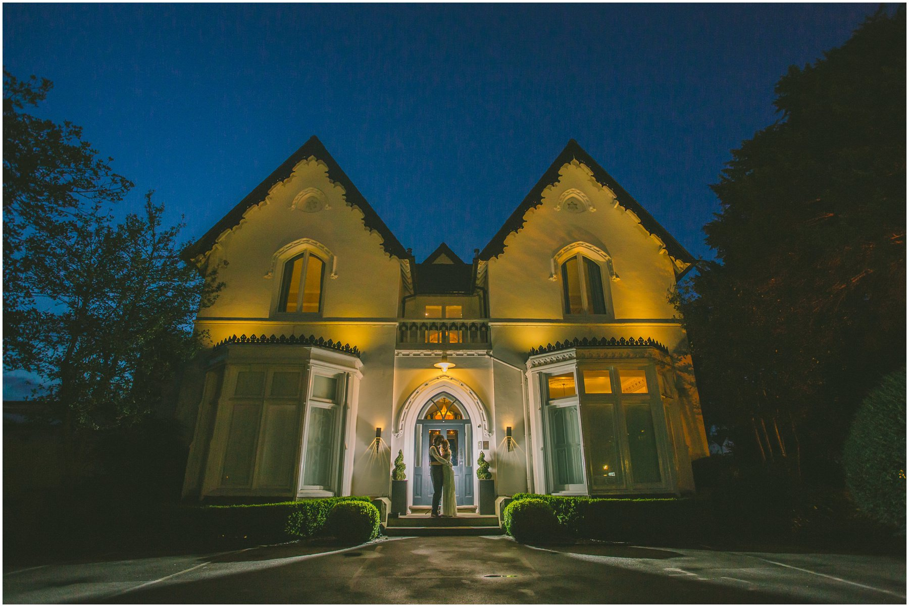 Final bride and groom portrait in front of the stunning Victorian villa at Didsbury House Hotel