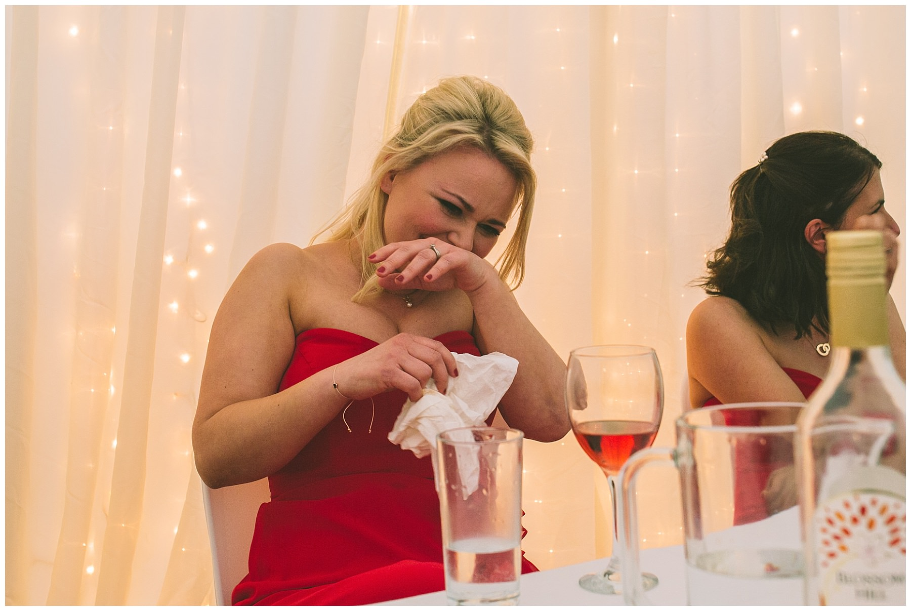 A bridesmaid nearly spits her drink out during speeches at Pentre Mawr