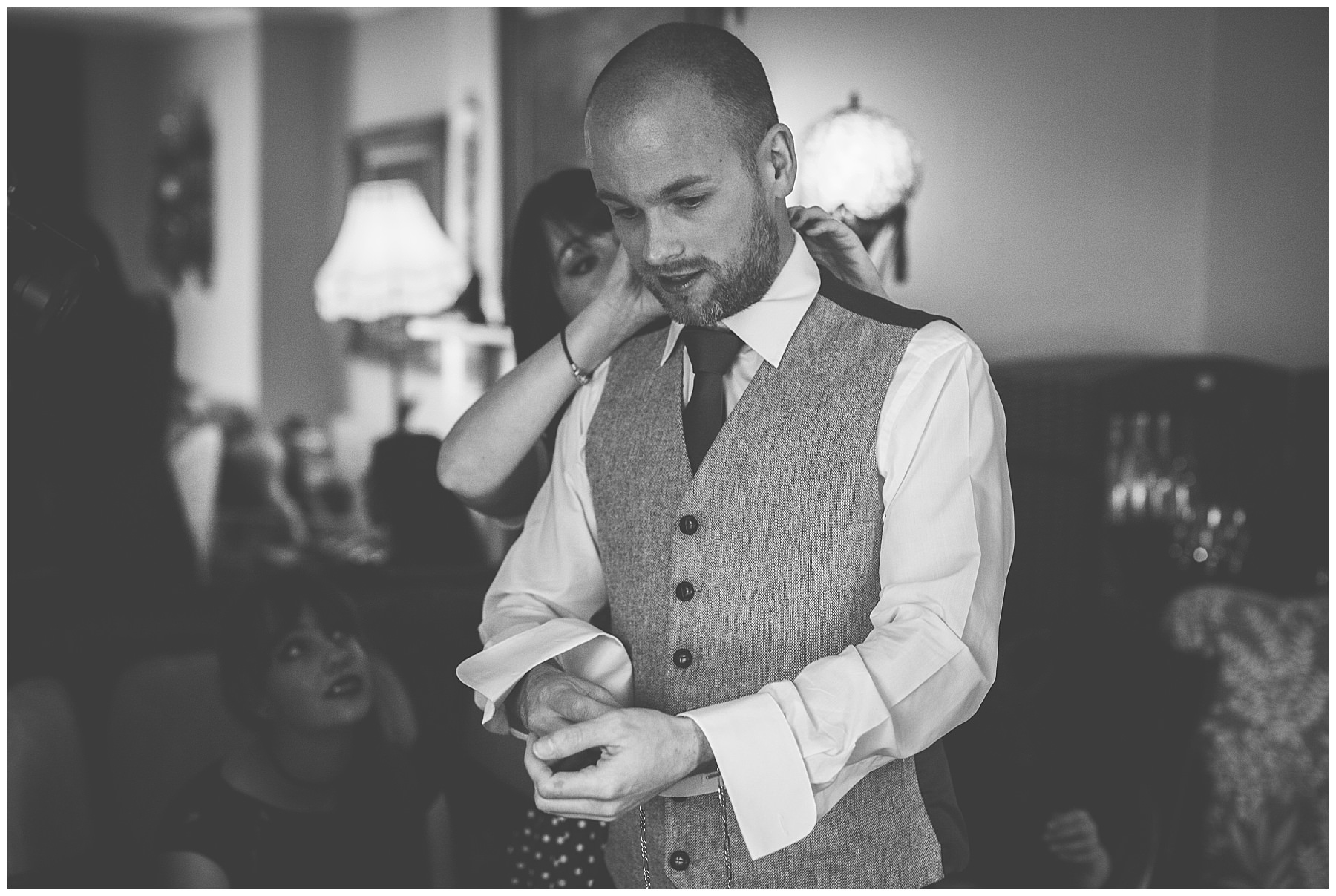 Groom applies his finishing touches before the wedding