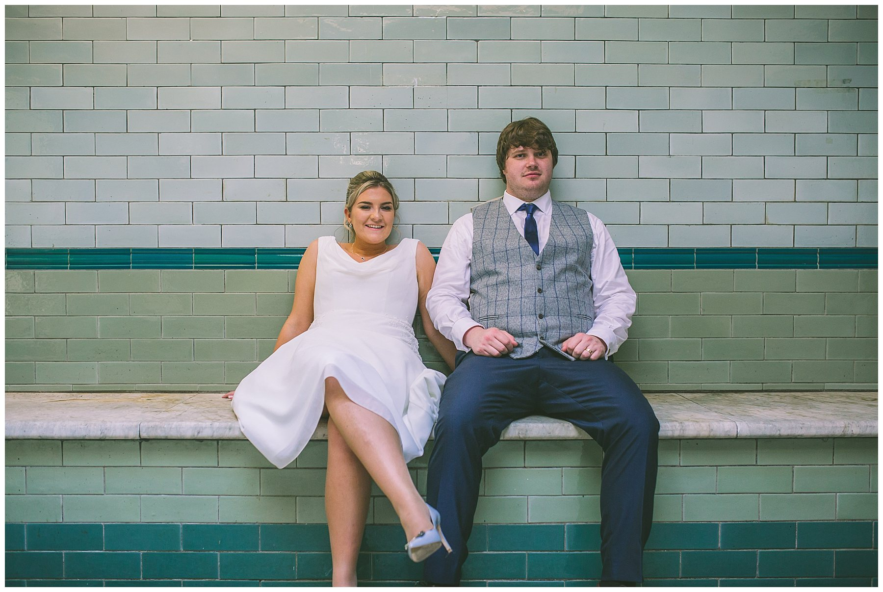 Bride and Groom take a seat to cool down at Victoria Baths
