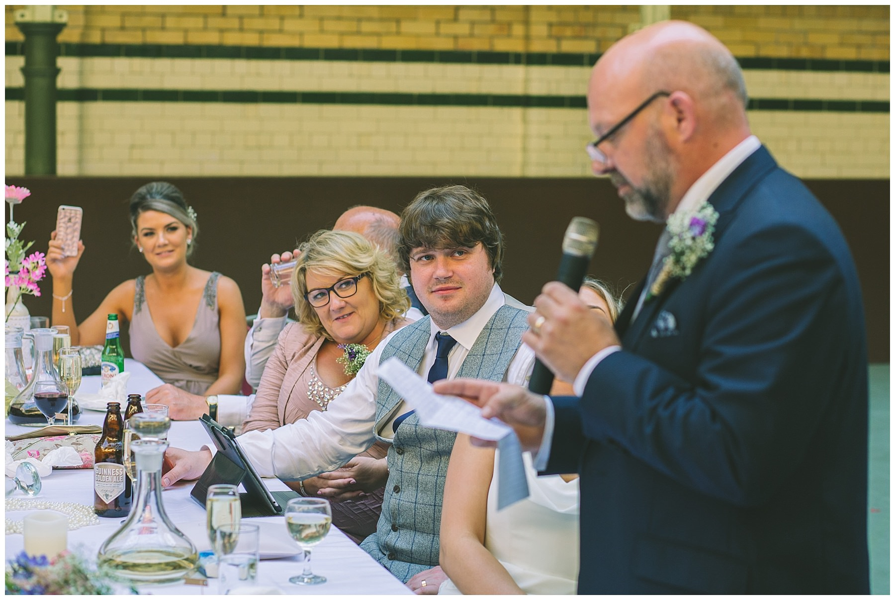 Groom looks on nervously during the father of the bride speech
