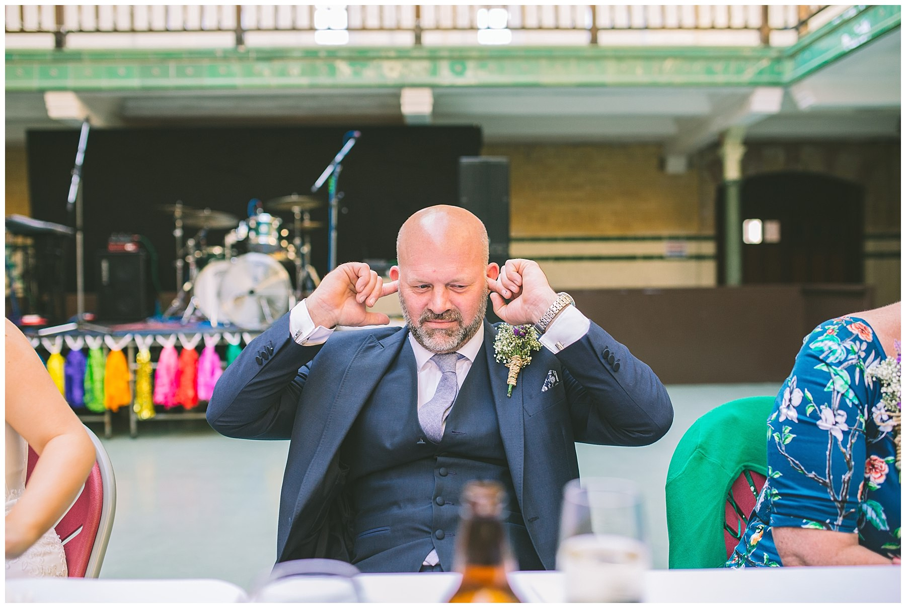 Brides father plugs his ears during the grooms speech at Victoria Baths