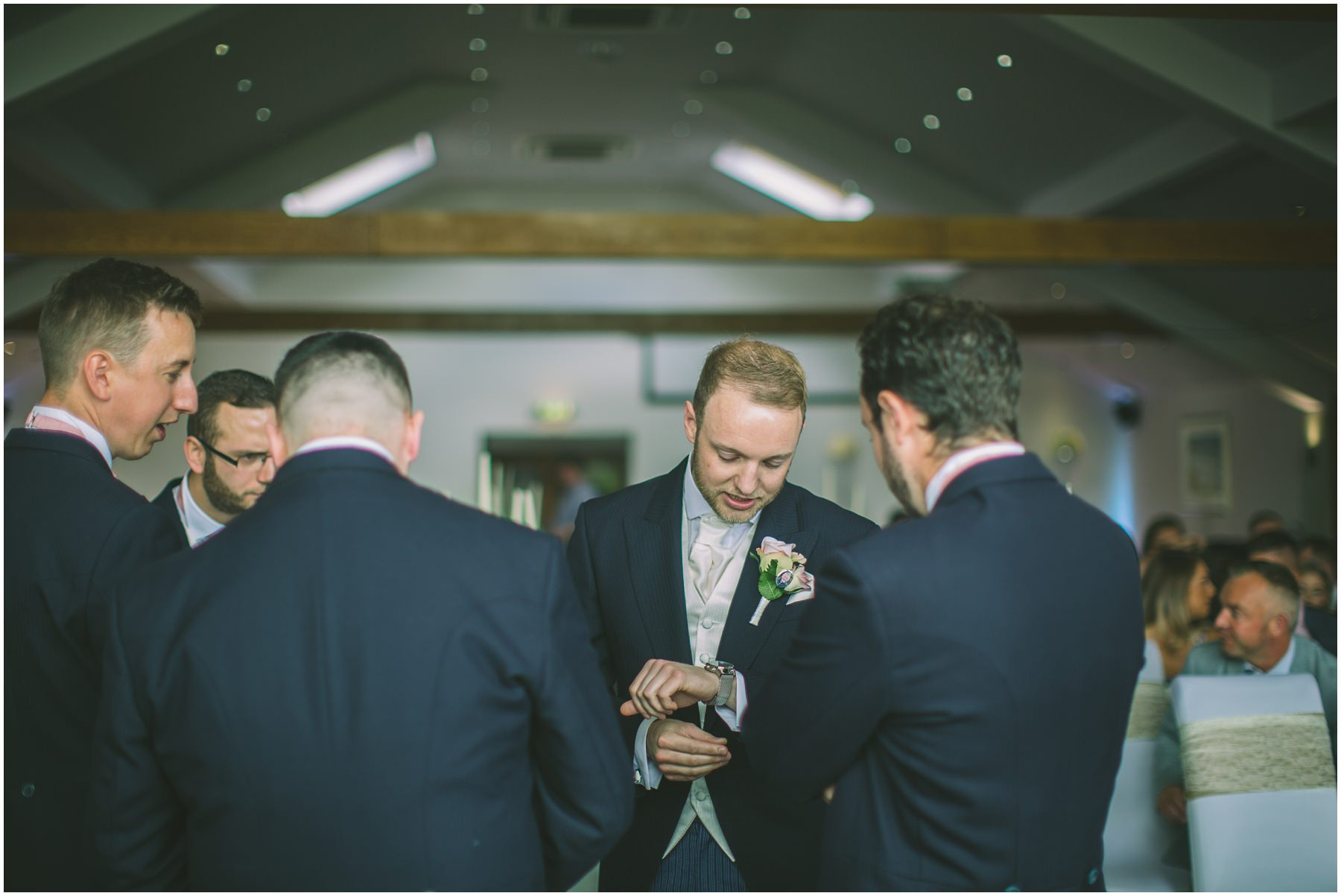 Groom checks the time at the fishermans retreat