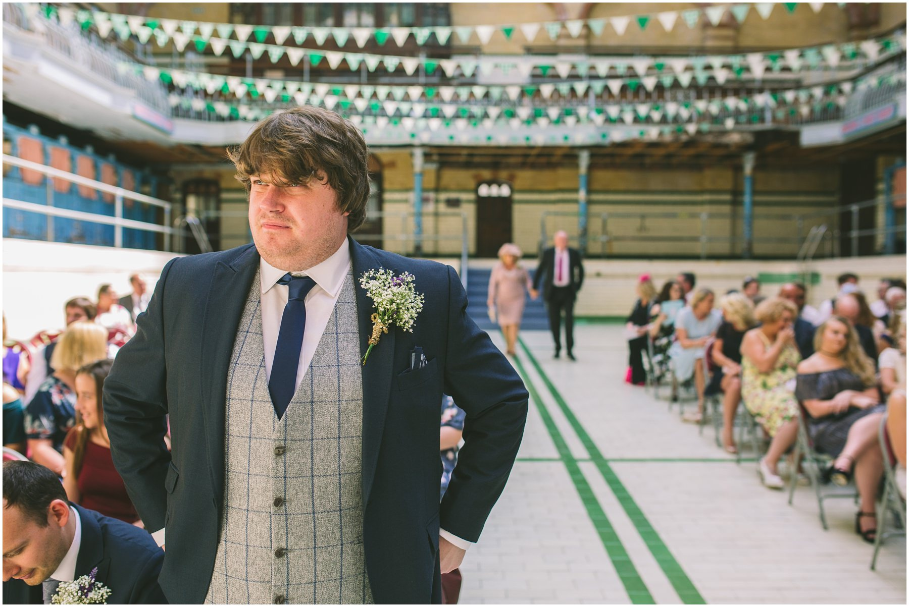 groom waits nervously in the pool at Victoria Baths
