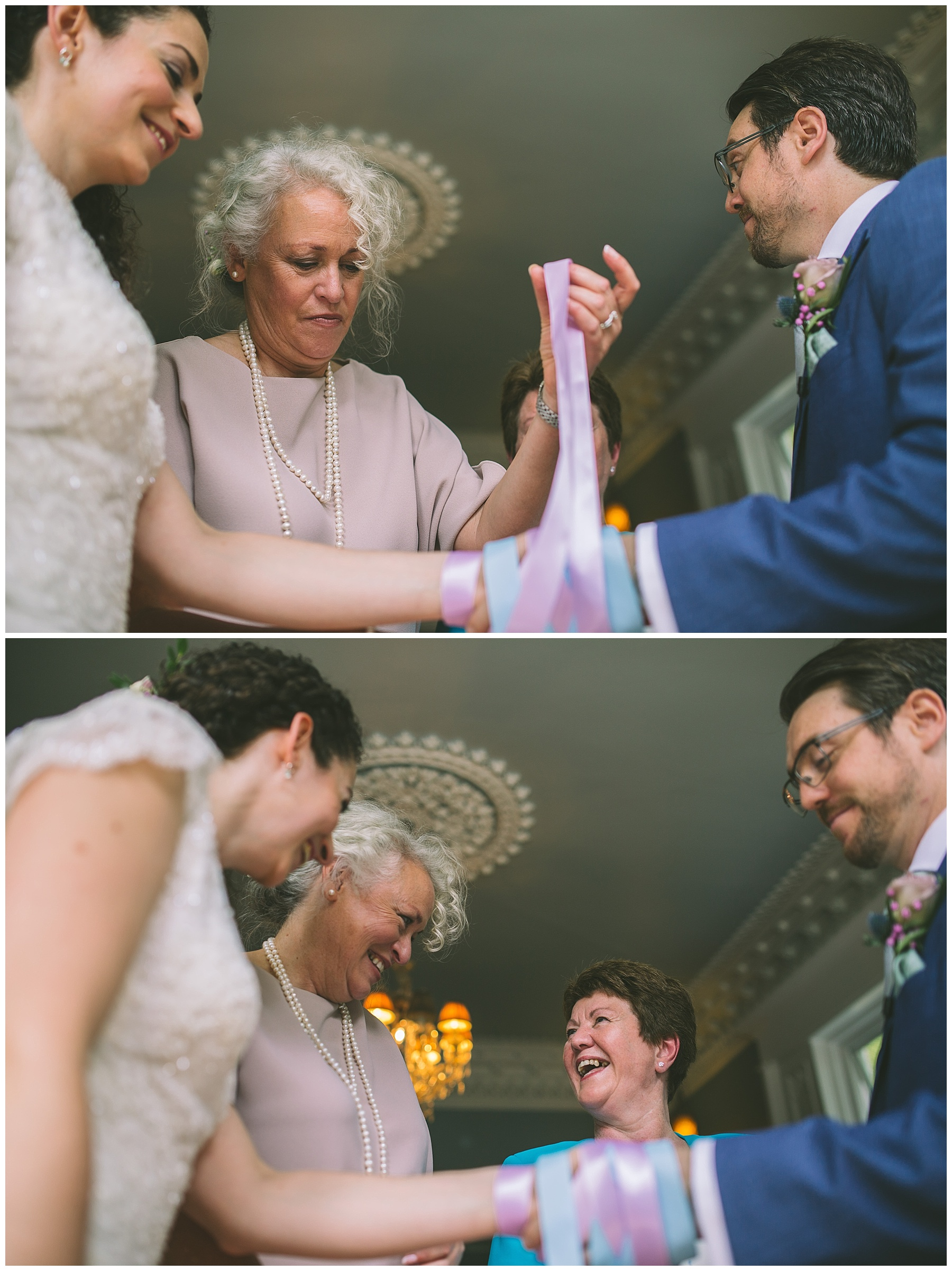 Mothers of the bride and groom bind the couples hands in a traditional handfasting