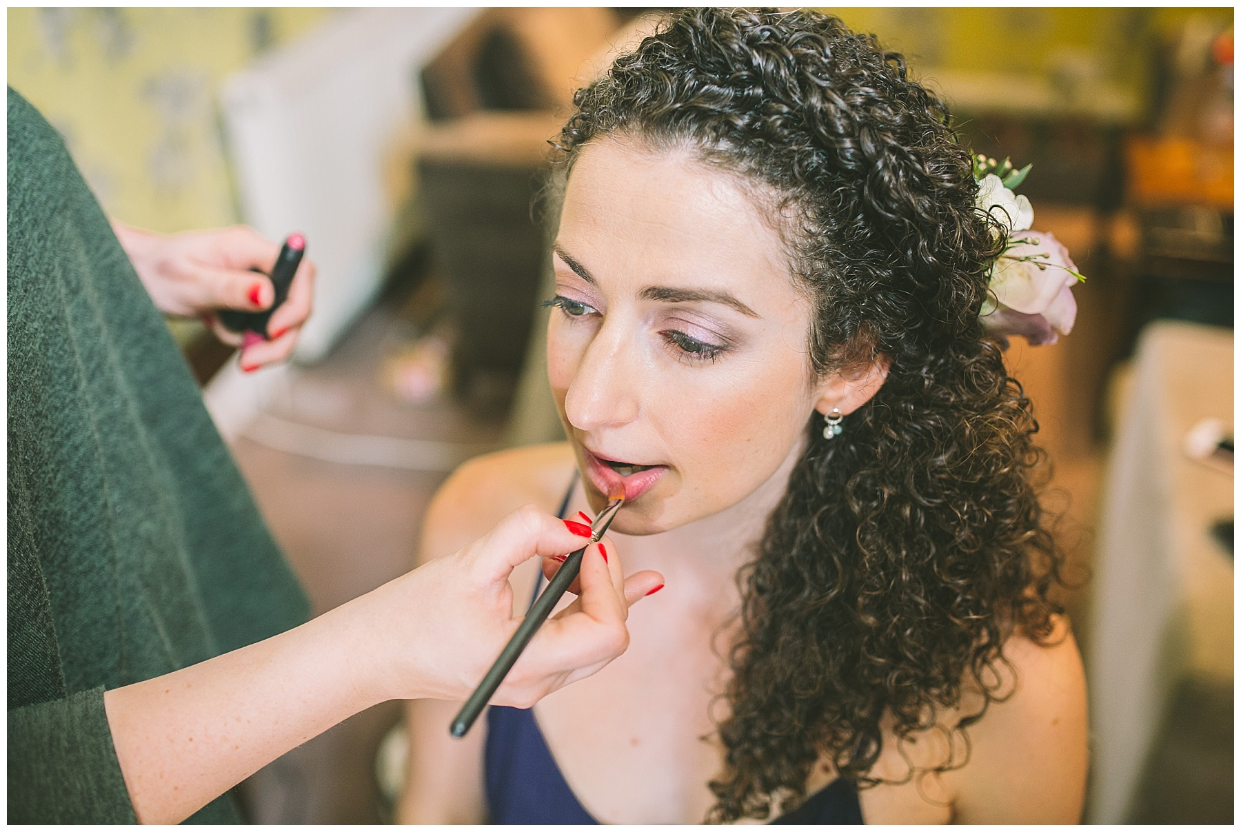 bride has lipstick applied for her didsbury wedding