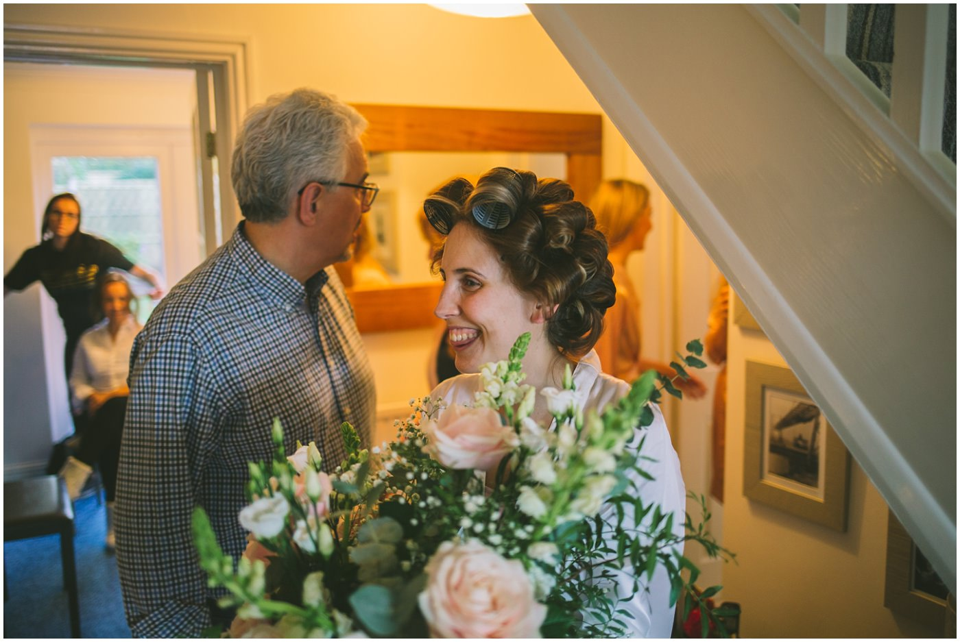 Bride receives a bunch of flowers on the morning of her wedding
