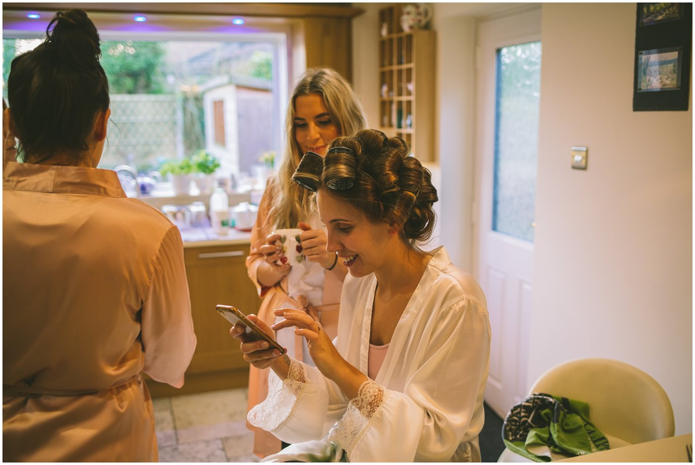 Bride to be becca checks her phone whilst getting ready