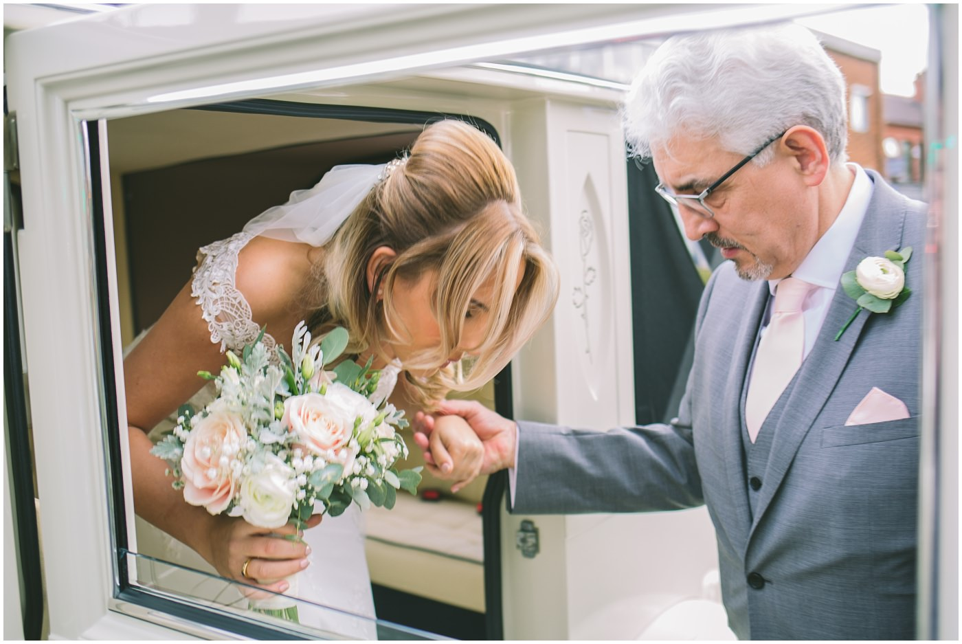 brides father helps her out of the wedding car