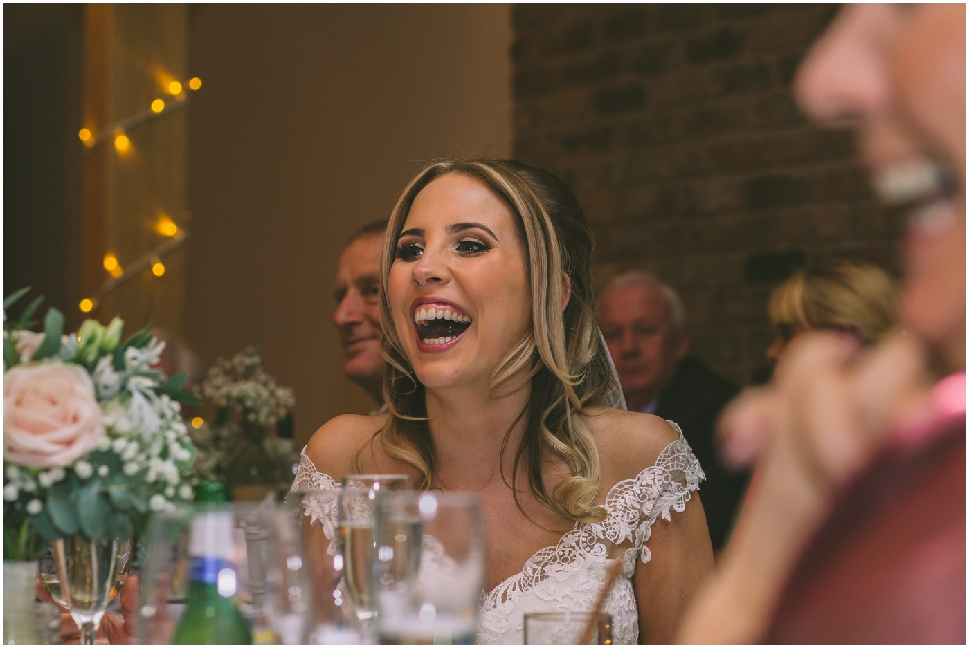 bride laughing during the speeches at her pryors hayes wedding