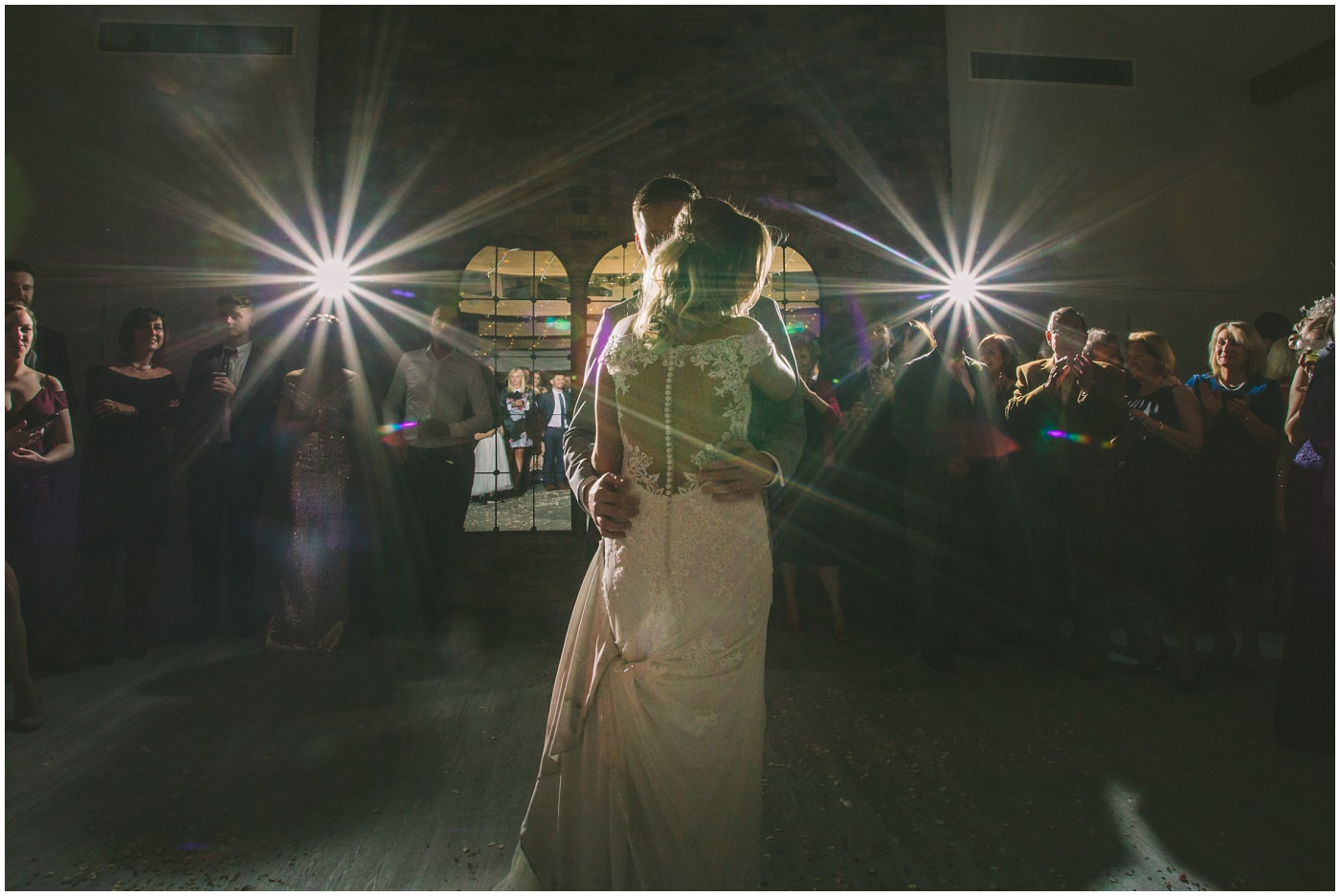 Bride and Groom embrace on the dance floor