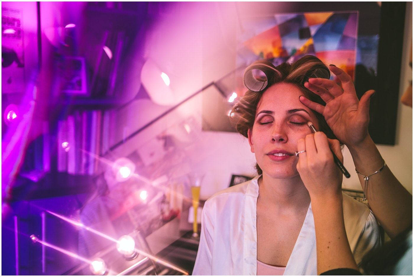 Creative photography of bride having her make up done for her Pryors Hayes Wedding