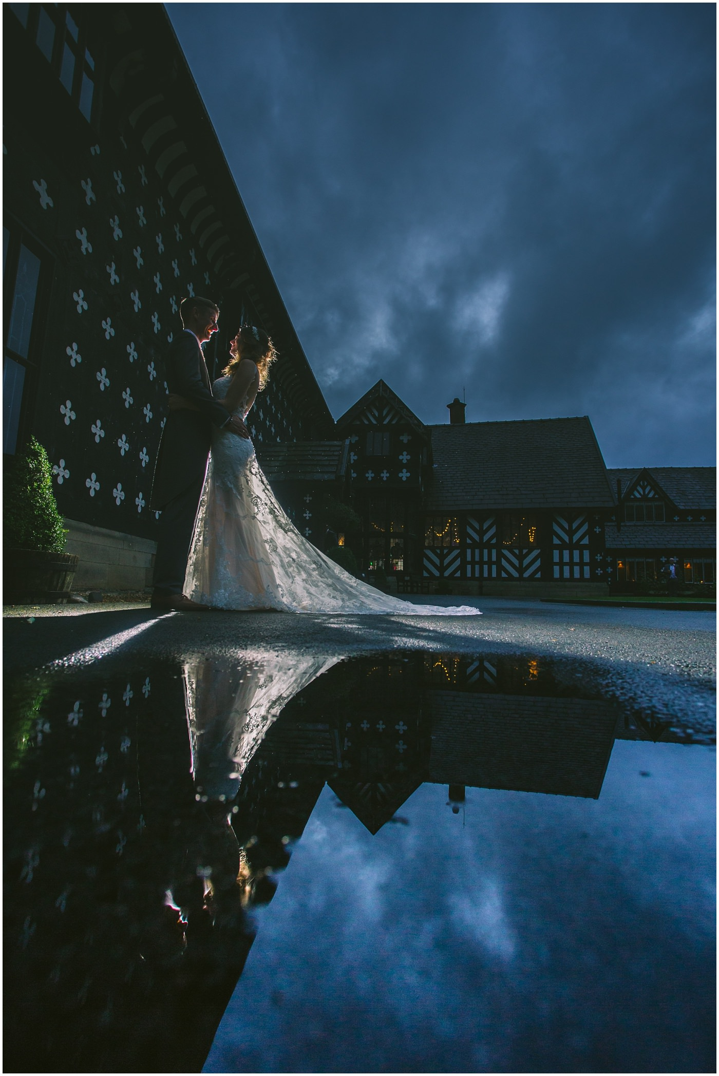 couple portrait with puddle reflection outside samlesbury