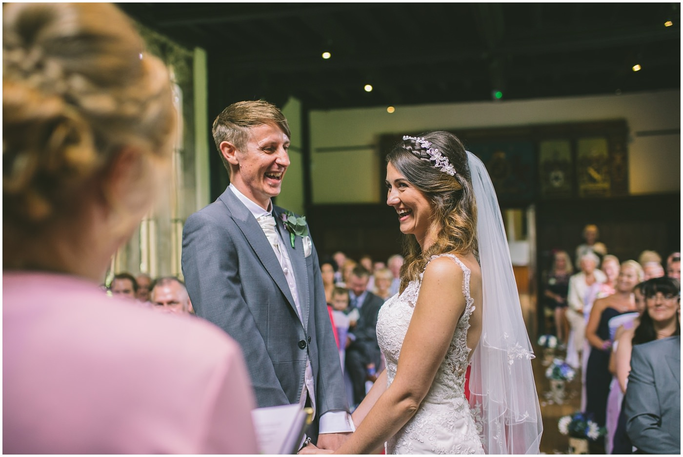 Happy couple are all smiles in their wedding ceremony