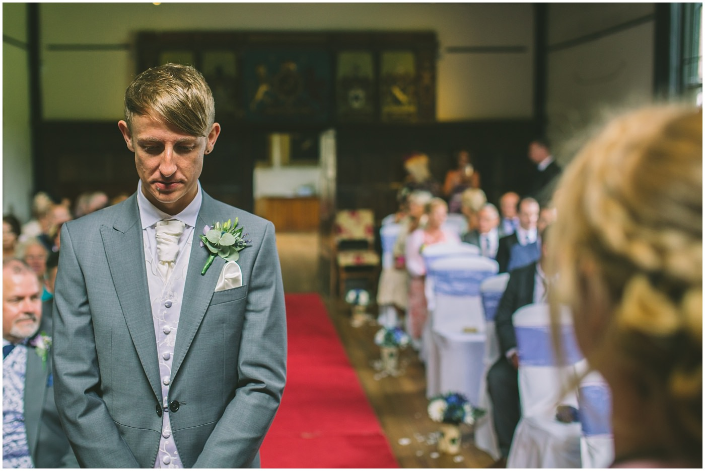 groom waits nervously for his bride