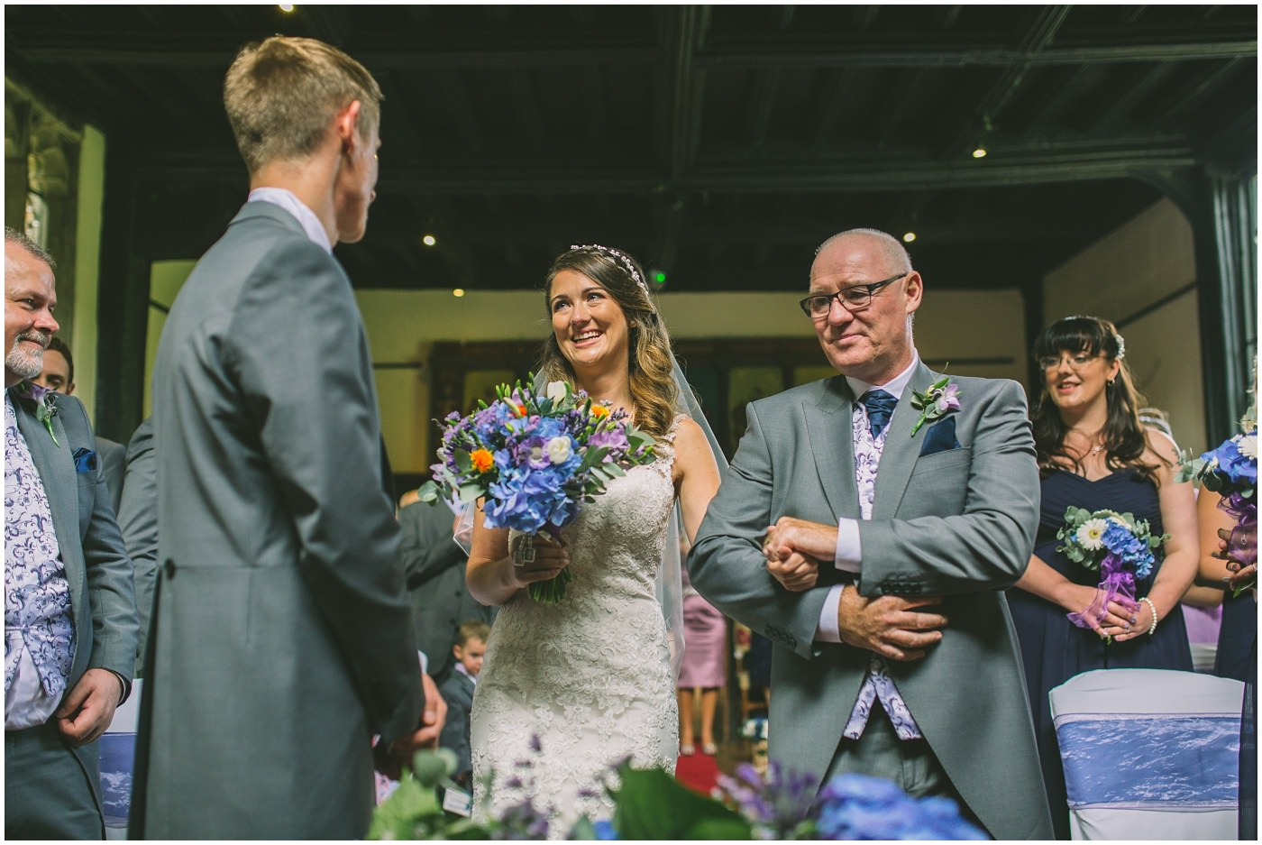 bride smiles at her groom as she arrives for wedding ceremony
