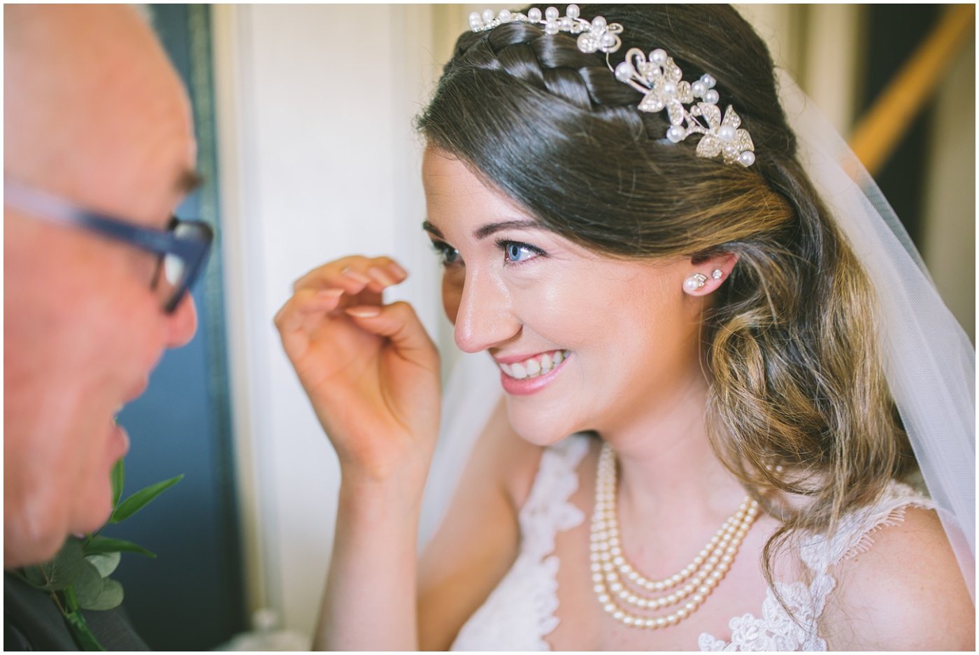 Tears from the bride as her dad sees her in her dress for the first time