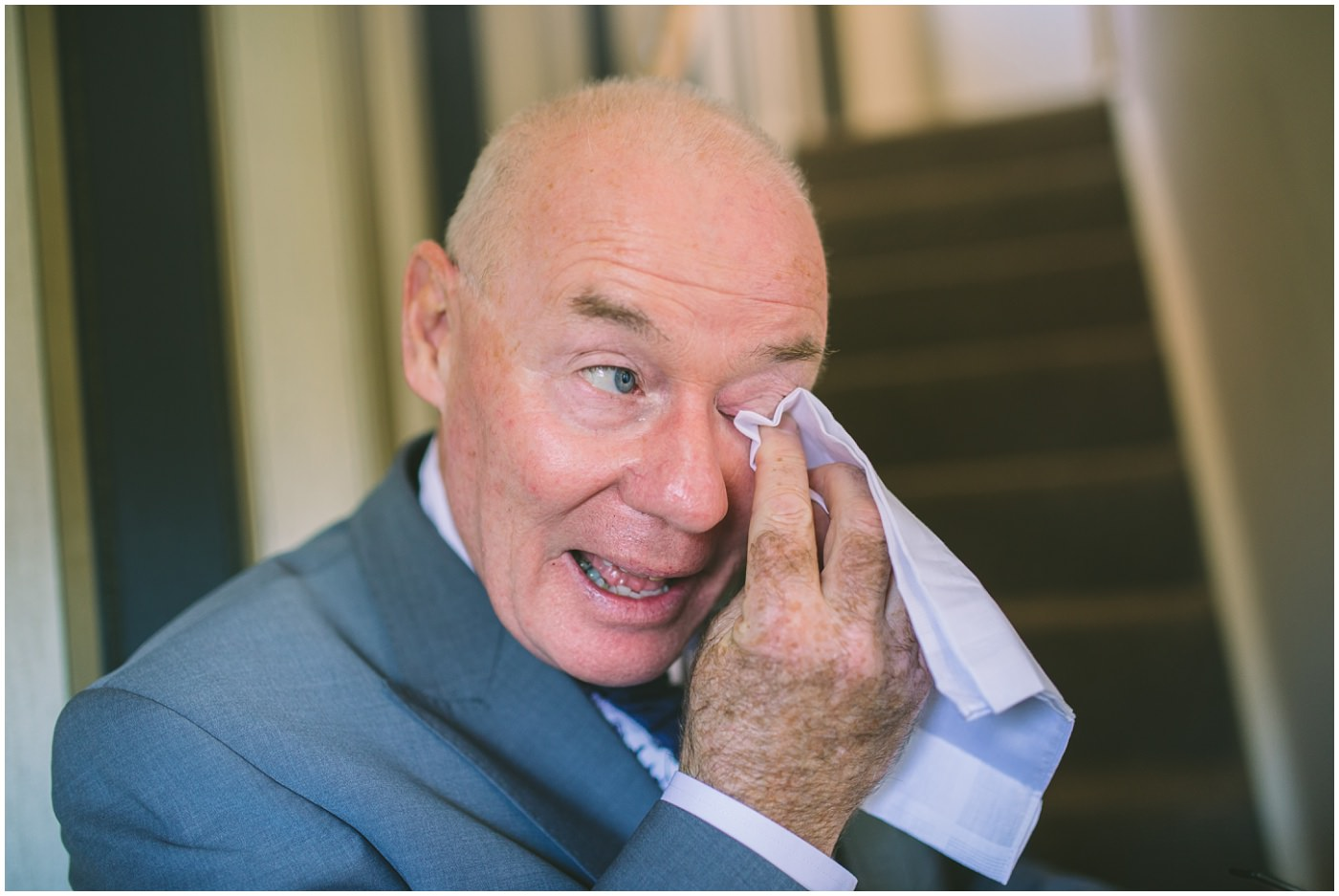 Father of the bride wipes away a tear