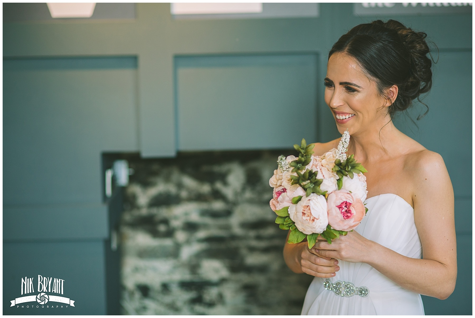 Bride to be smiles as she sees her bride for the first time