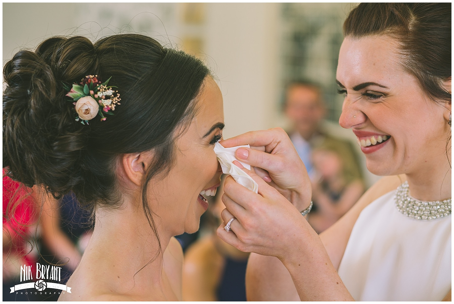 bride wipes a tear from her wifes eye during Lancashire Wedding