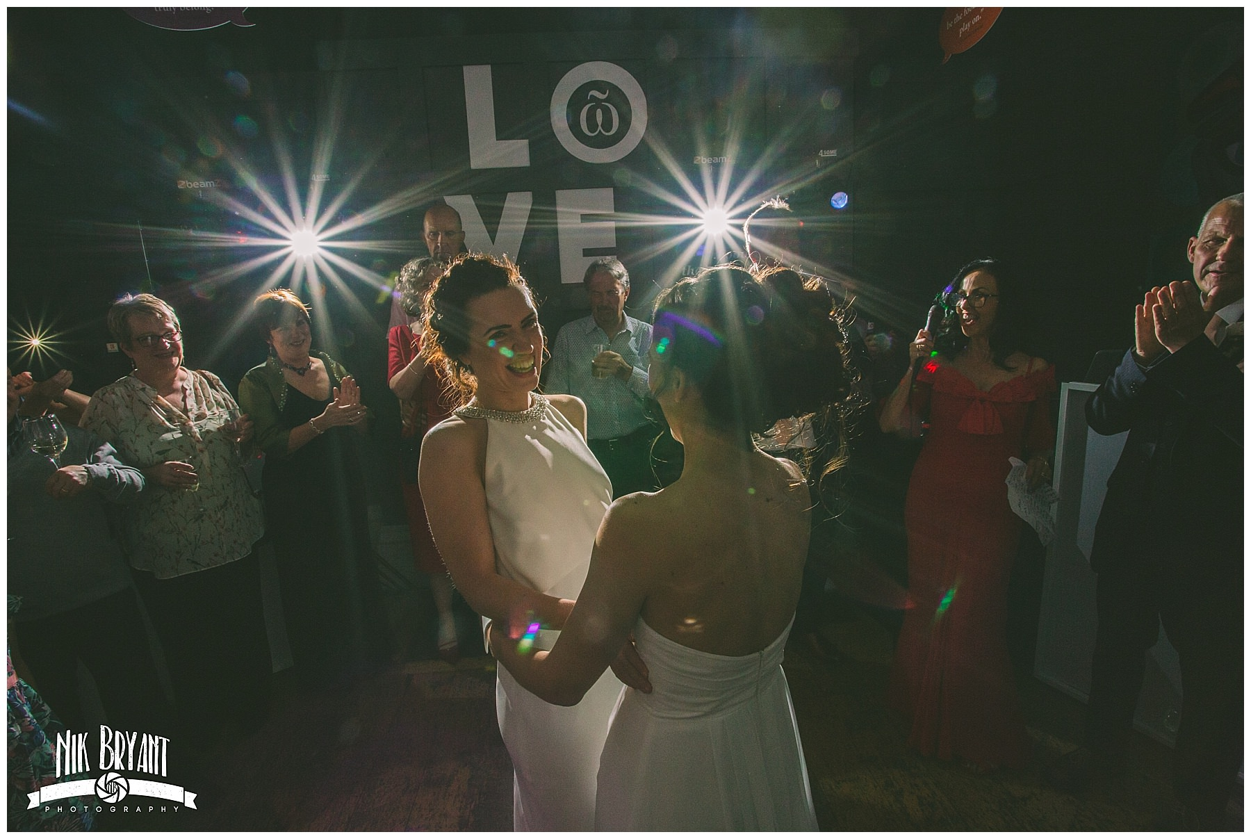 Two brides share their first dance with family and friends