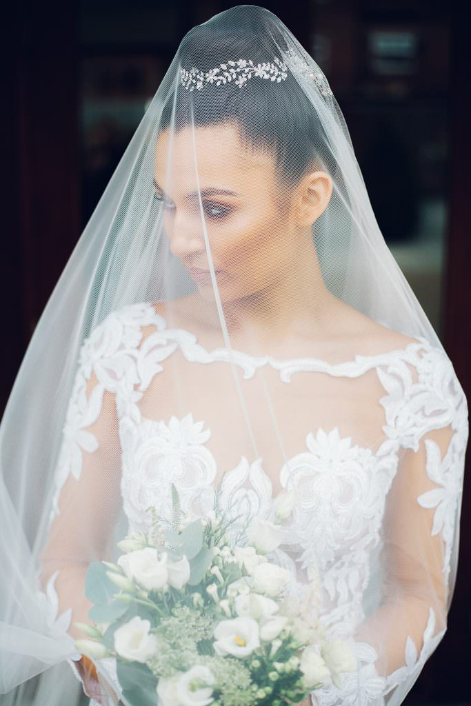 Wedding Bride unde veil at sandhole oak barn