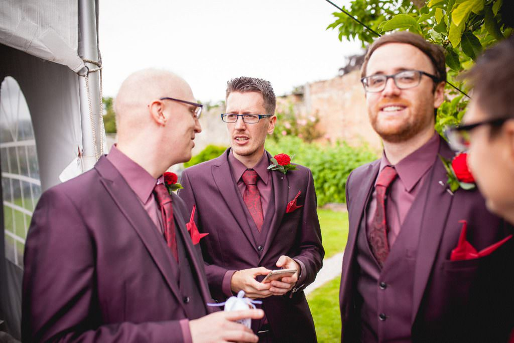 Groomsmen stand chatting