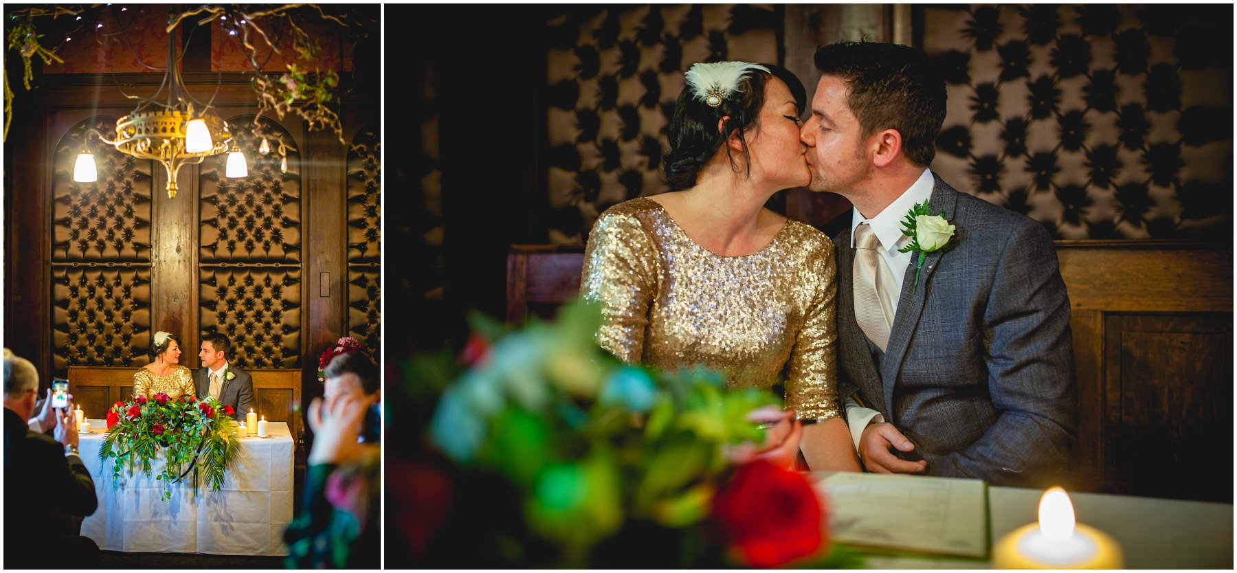 bride and groom have a kiss while signing the register