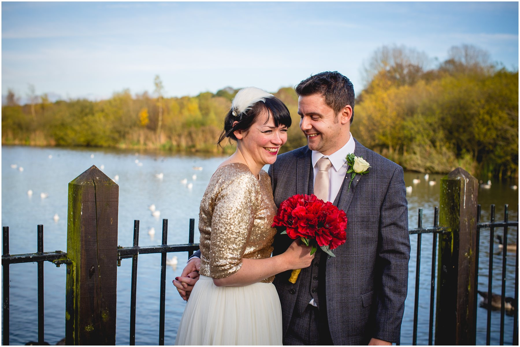 Newly wed couple have a laugh at the park