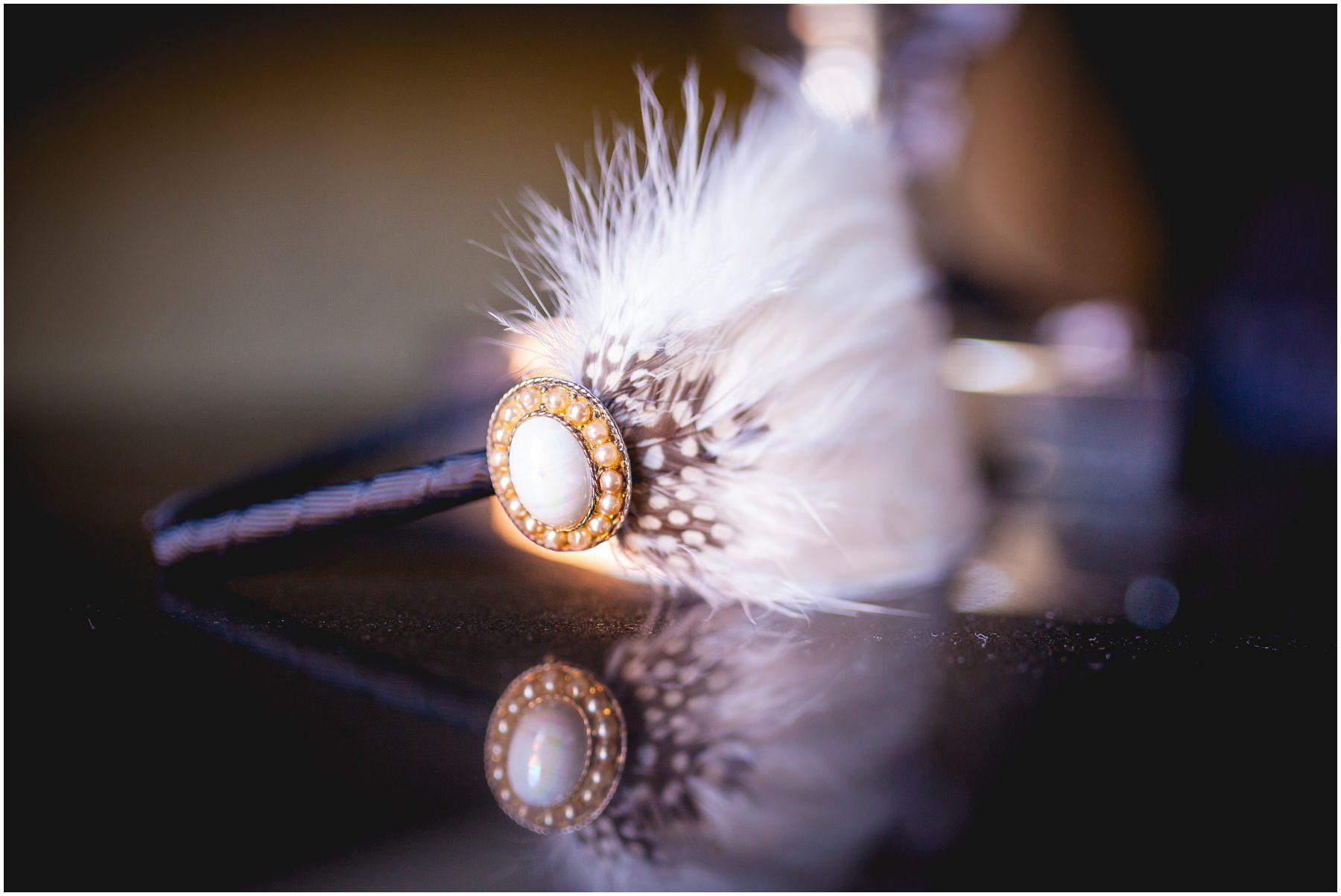 A hair accessory sat on a bedside table