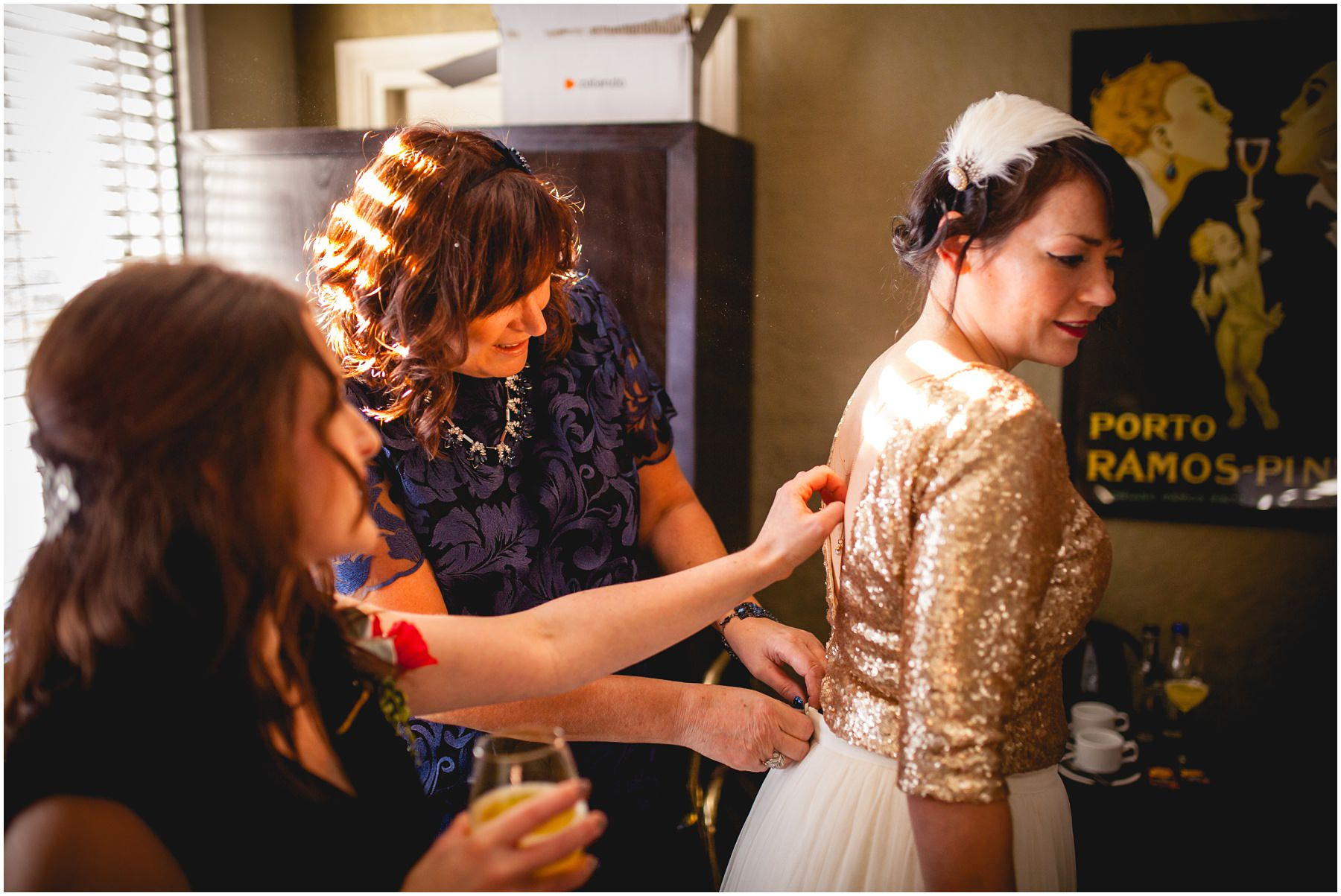 mum and bridesmaid assist with final touches