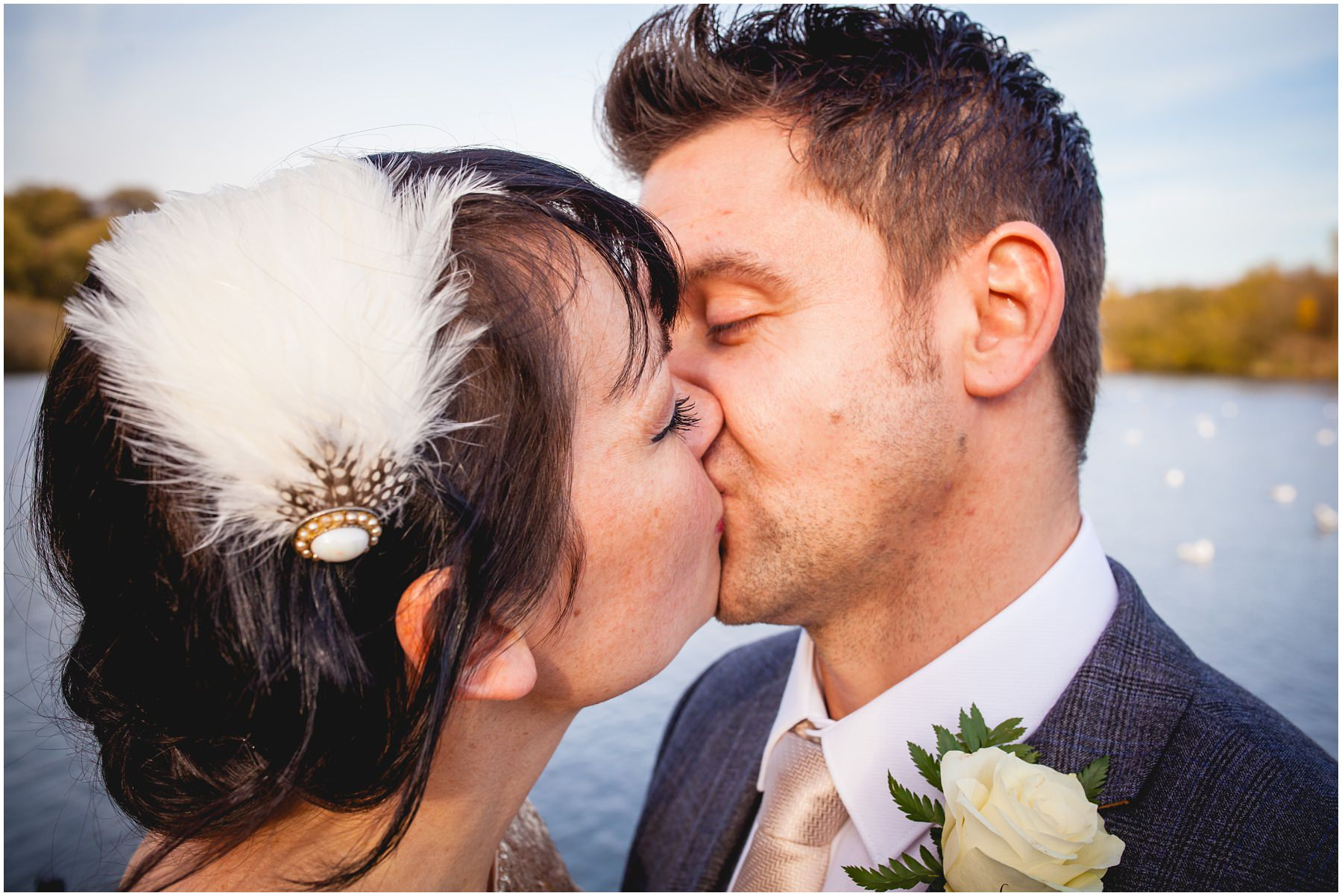 newly wed couple share a kiss