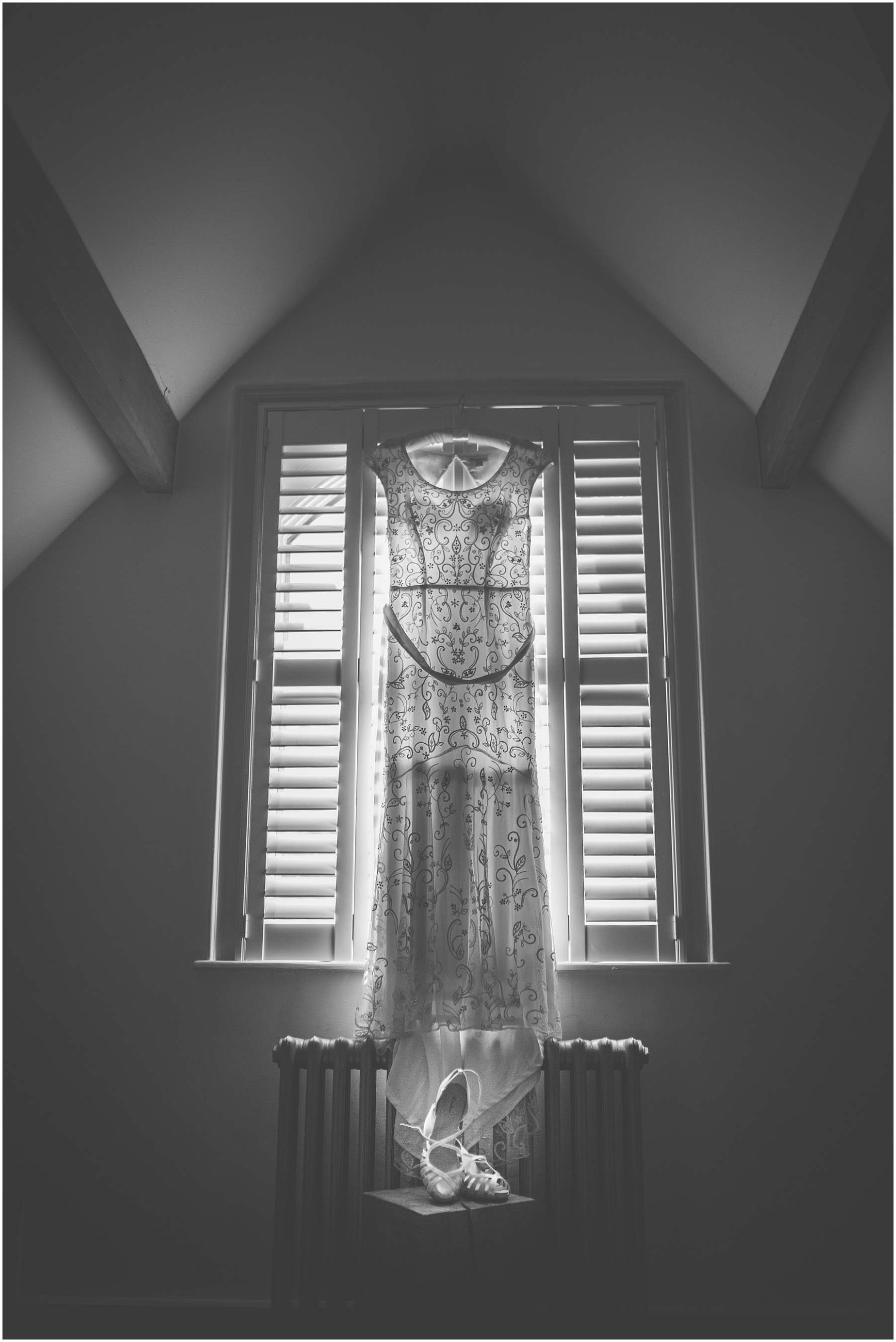 Wedding dress hangs in the bedroom of Didsbury House Hotel