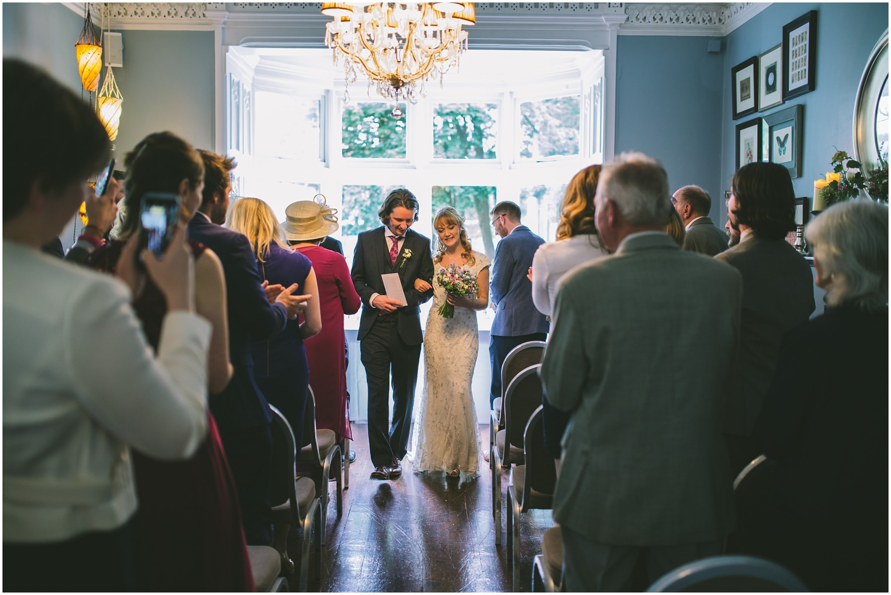 Bride and Groom exit the Blue Room at Didsbury House