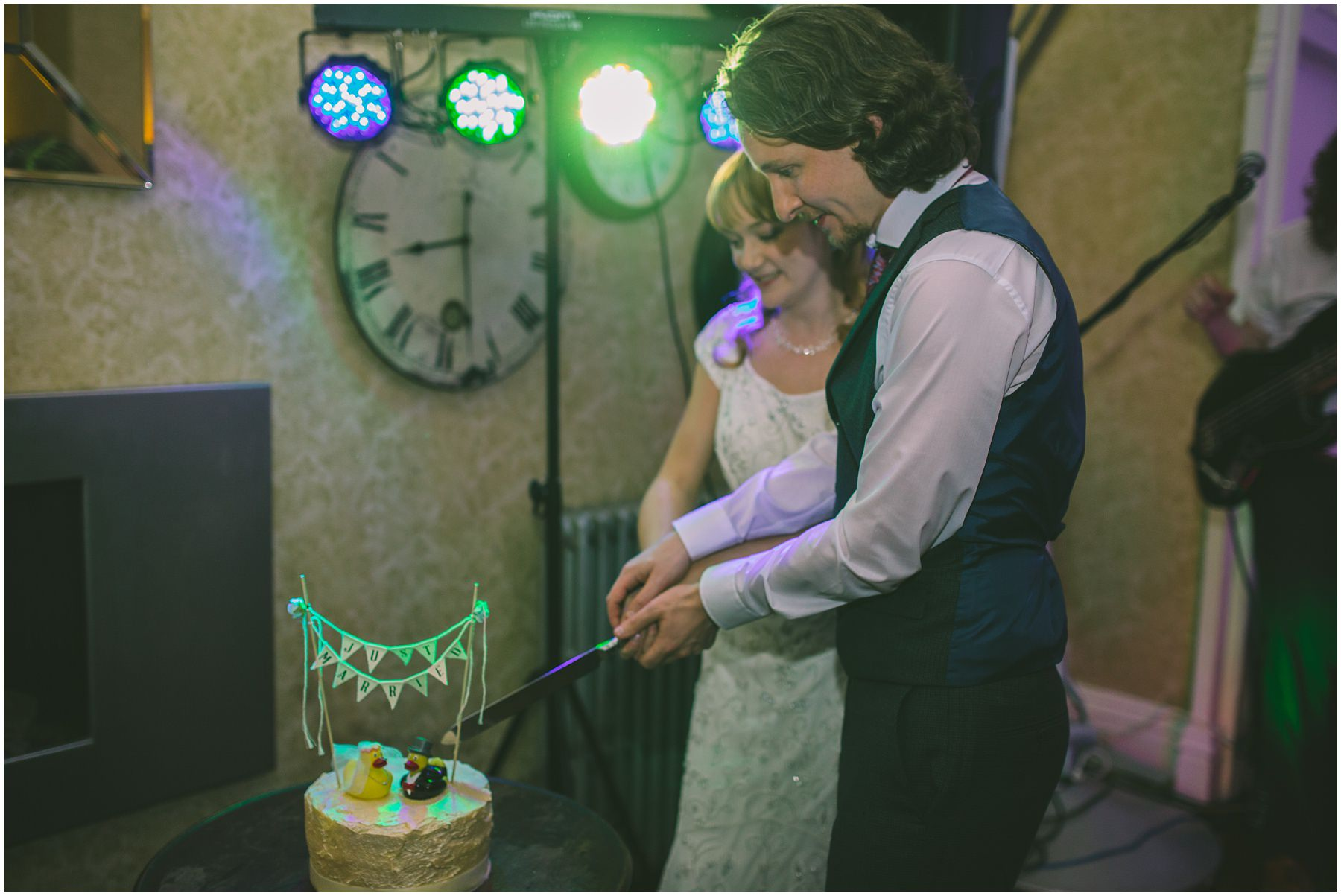 Bride and Groom cut the wedding cake at Didsbury House