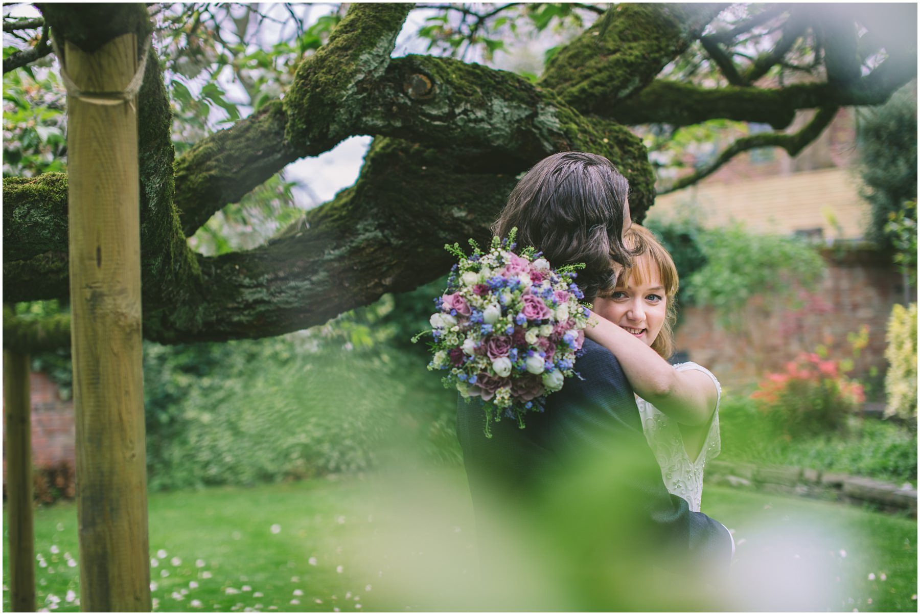 Bride and Groom share a moment under the tree at Eleven Didsbury Park
