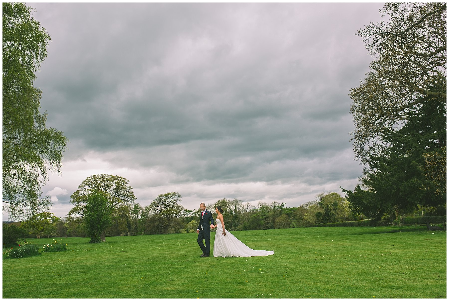 Newlyweds take a stoll over the lawns at Pentre Mawr
