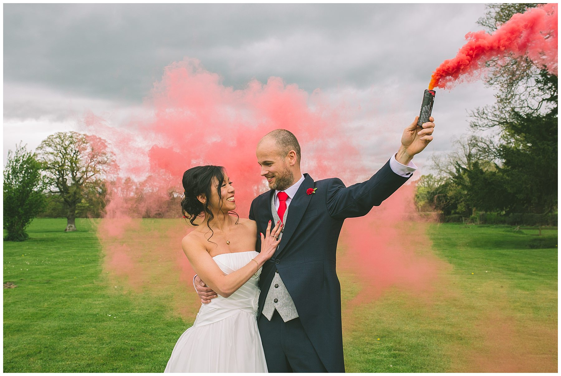 Red Smoke and a loving couple