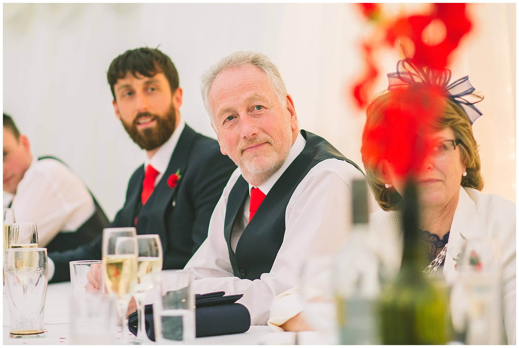 Grooms father watches on during speeches