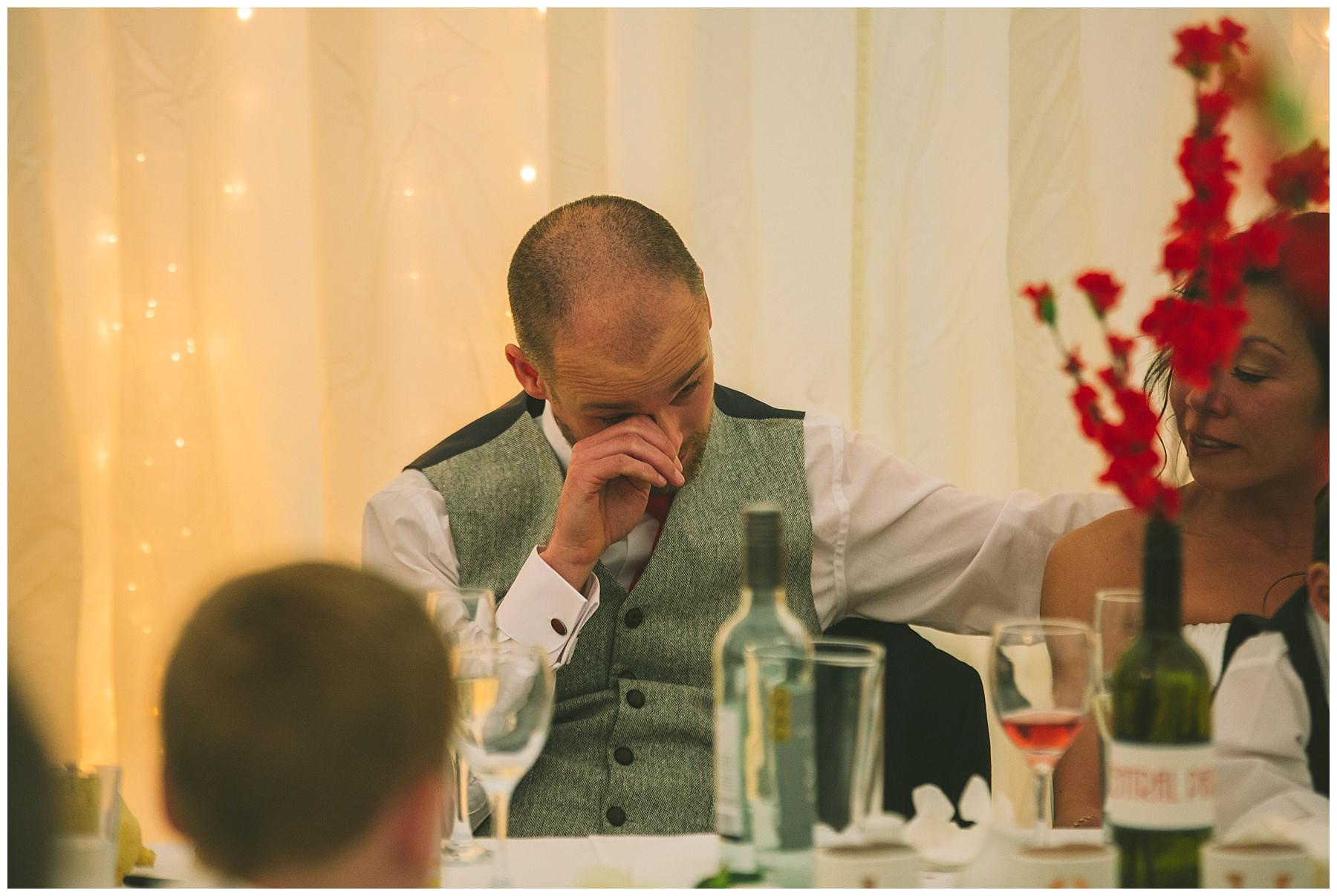 groom sheds a tear during the best mens speech
