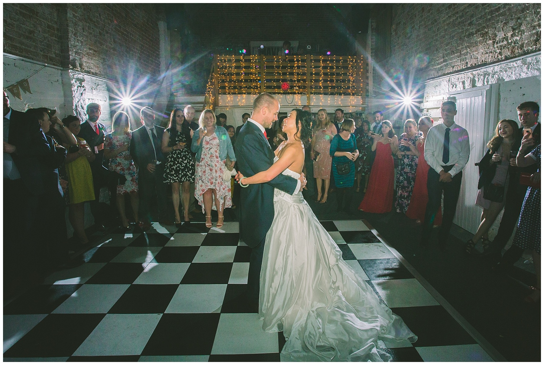 The happy couple take to the floor for their first dance in the barn at Pentre Mawr