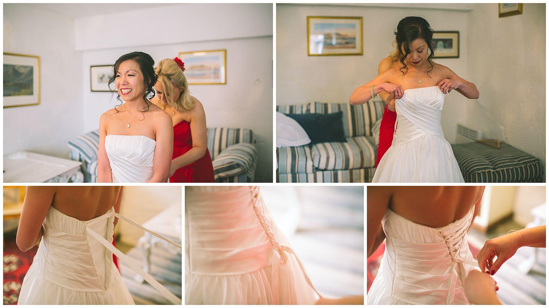 Bride gets her wedding dress on at Pentre Mawr