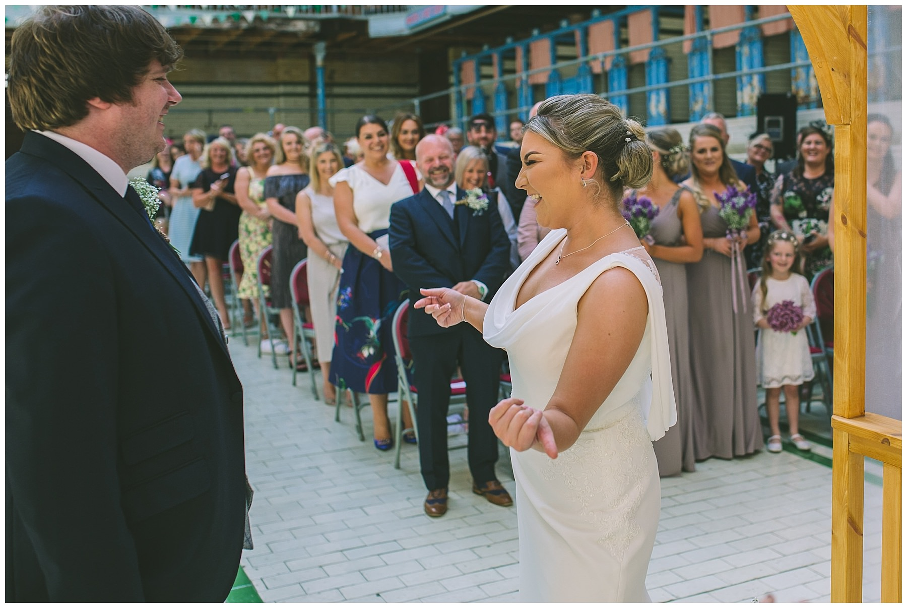 bride shows off during her wedding ceremony