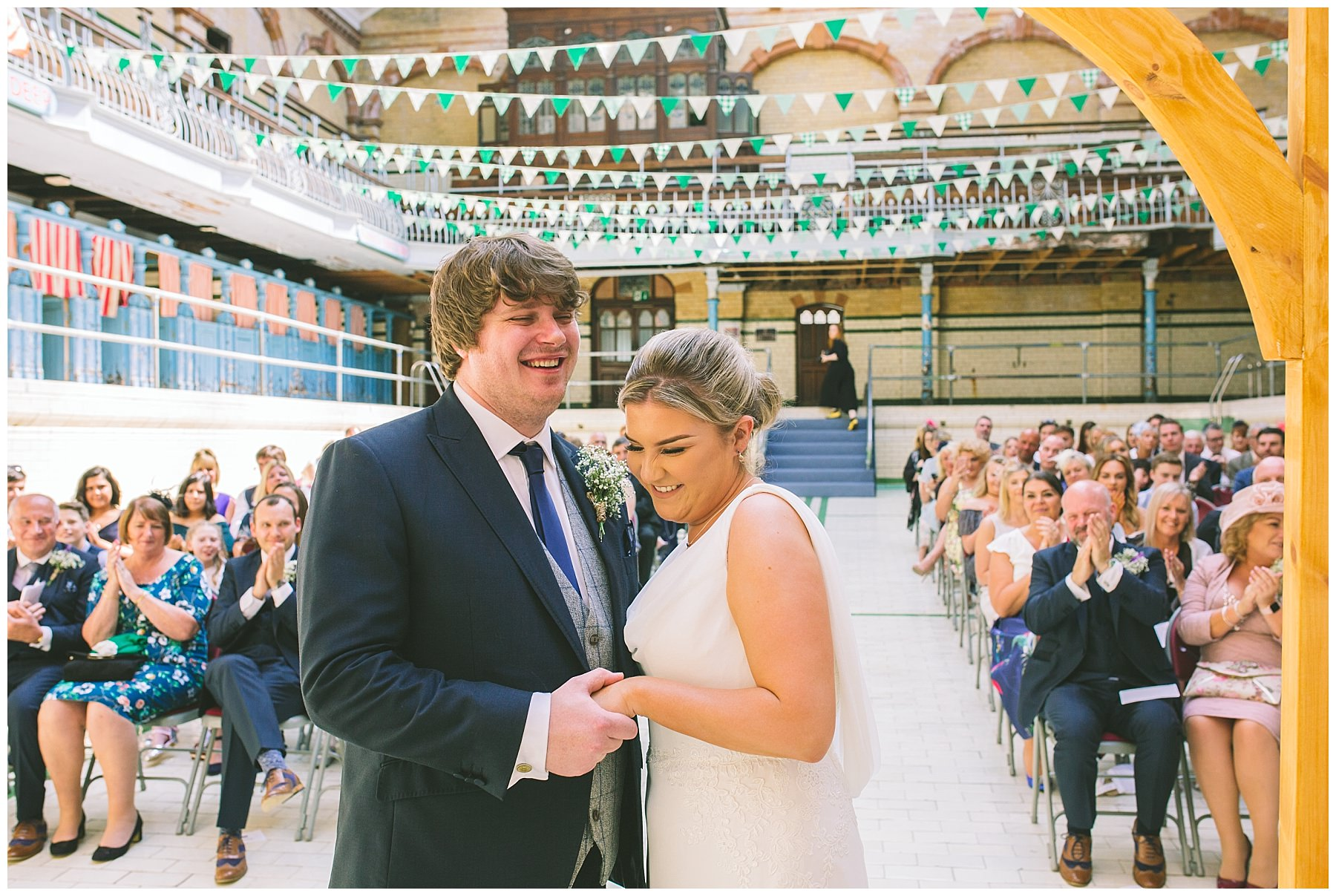 Bride and Groom laugh during the ceremony at Victoria Baths