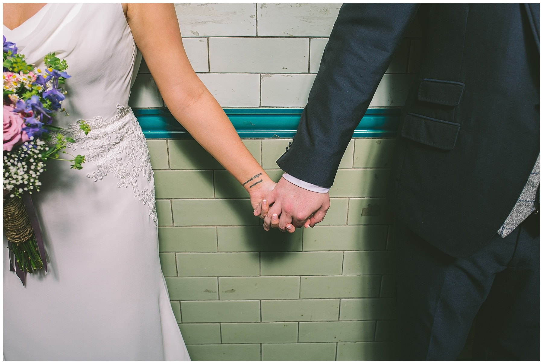 Bride and Groom hold hands at Victoria Baths