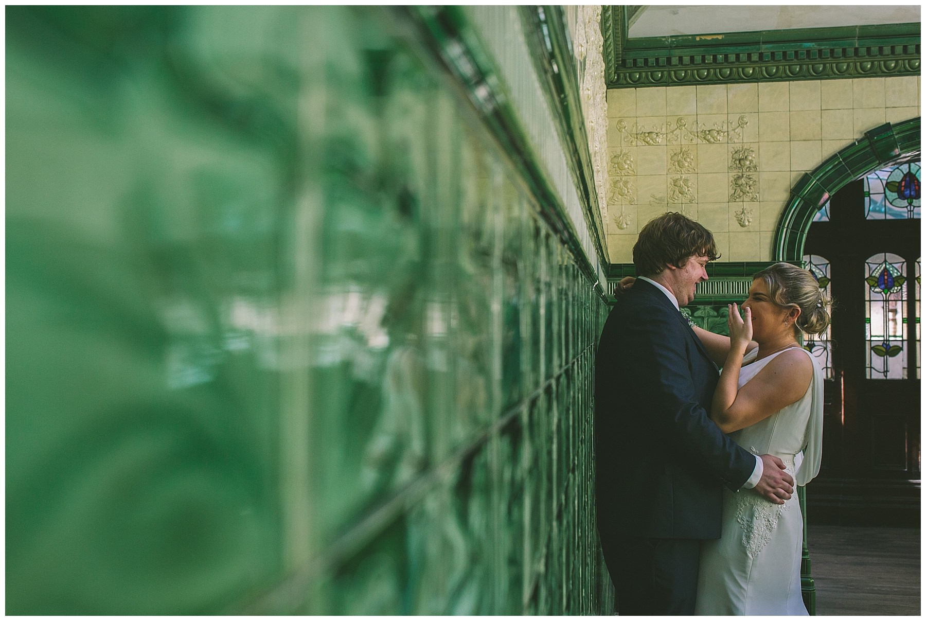 Bride and Groom share a joke during their wedding photos at Victoria Baths