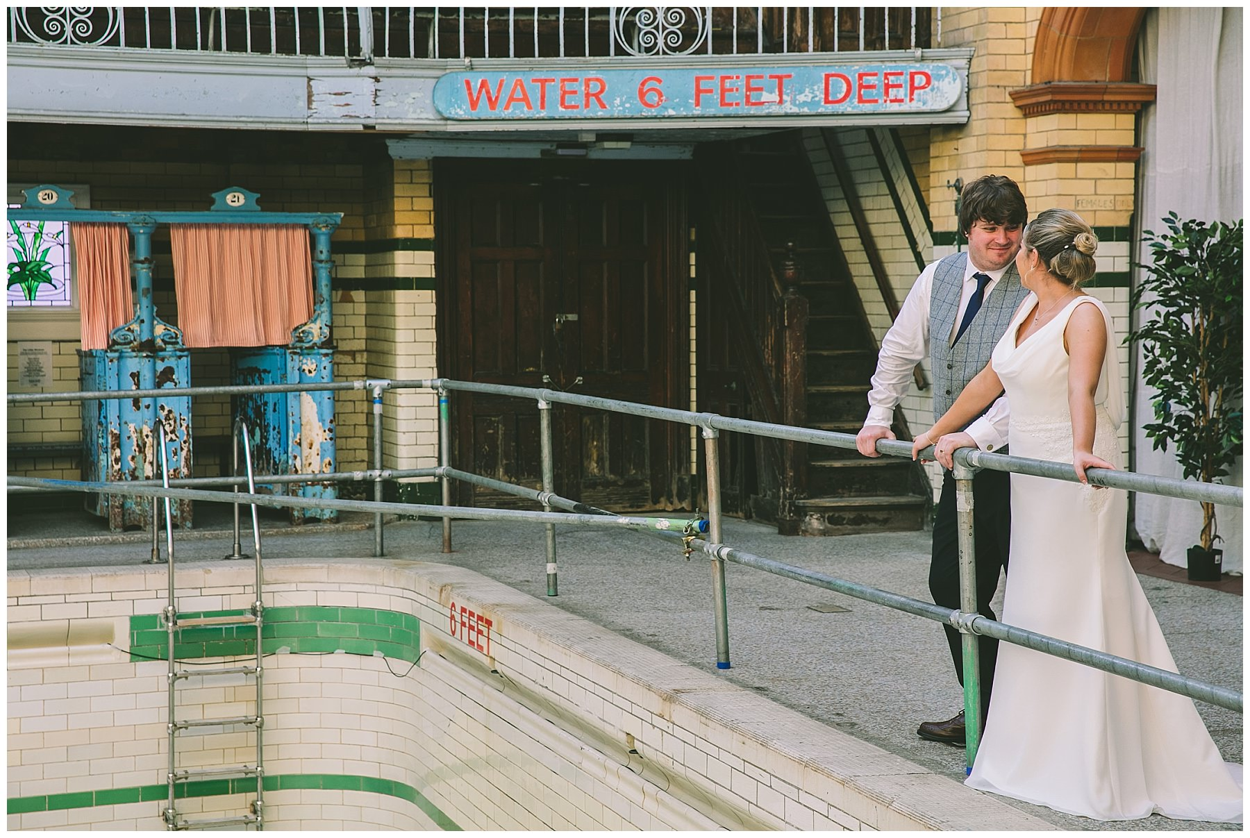 Bride and Groom at the deep end of the pool at Victoria Baths