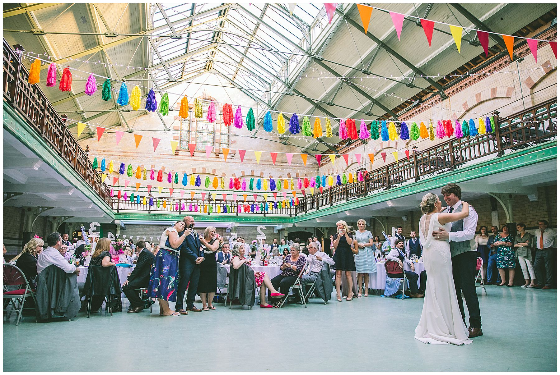 The happy couple share their first dance with friends and family at Victoria Baths